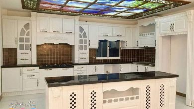 Photo of طراحی آسمان نما برای آشپزخانه ای با کابینت ممبران سفید