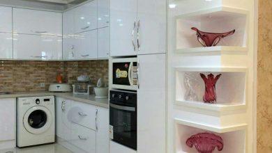 Photo of کابینت مدرن سفید هایگلاس با صفحه شرکتی 5 سانتی