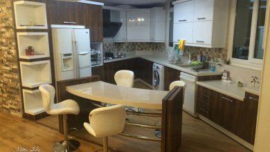 Photo of آشپزخانه ای عجیب اما خوش اجرا با ترکیب رنگ سفید و طرح چوب